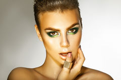 Young fashion model with green colors makeup looking at camera Stock Photo