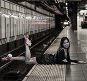 Young fashion model posing at NYC subway. Stock Photos