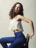 Young fashion model sitting on chair Royalty Free Stock Photos