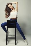 Young fashion model sitting on chair Stock Image