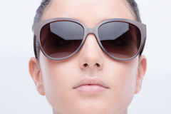 Young fashion model with sunglasses Stock Photography