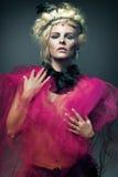 Young fashion model wearing designer dress. Stock Photos