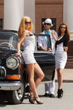 Young fashion people at the retro car Stock Photography