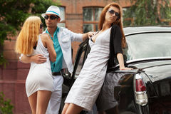 Young fashion people at the retro car Stock Images