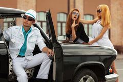 Young fashion people at the retro car Royalty Free Stock Images