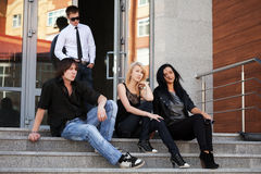 Free Young Fashion People Sitting On The Steps Royalty Free Stock Photography - 41126647