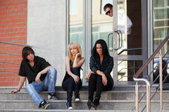 Young fashion people sitting on the steps Stock Image