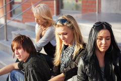 Young fashion people sitting on the steps Royalty Free Stock Photography