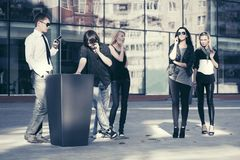 Young fashion people talking on cell phones in city street stock photos