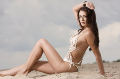 Young fashion pretty sexy woman on the beach Stock Photos