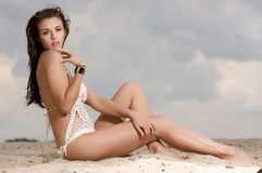 Young fashion pretty sexy woman on the beach Royalty Free Stock Photography