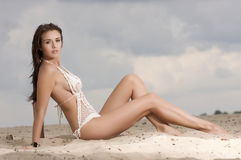 Young fashion pretty sexy woman on the beach Stock Photography