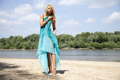 Young fashion pretty sexy woman on the beach Royalty Free Stock Photos