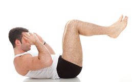Young fashion sport man fitness muscle model guy exercise isolat Stock Photography
