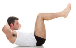 Young fashion sport man fitness muscle model guy exercise isolat Royalty Free Stock Image