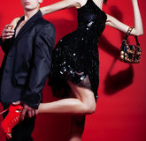 Young fashion style couple man and woman on red sexy background, luxury stuff, lifestyle modern people sale concept Royalty Free Stock Photo