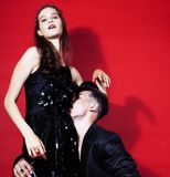 Young fashion style couple man and woman on red sexy background,. Young fashion style couple men and women on red sexy background, luxury stuff, lifestyle modern Royalty Free Stock Image