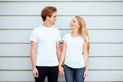 Young fashion stylish couple stand on streets of the city in summertime royalty free stock photo
