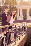Young fashion stylish Hipster couple in love on the bridge lover Royalty Free Stock Photo