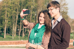 Young fashion stylish Hipster couple take a selfie stock photo