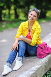 Young fashion teenager smiling in a park Royalty Free Stock Images