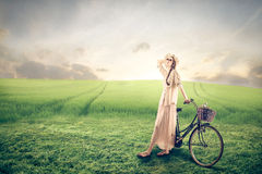 Young fashion woman with a bike Stock Photos