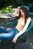 Young fashion woman in bodysuit-nude color and blue boho style j stock image