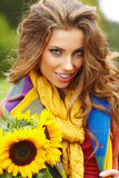 Young fashion woman with a bouquet of sunflowers Royalty Free Stock Images