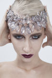 Young fashion woman with bright makeup, lady. Winter with ice crystal diadem. cold concept on face close up Stock Photo