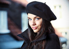 Young fashion woman  in the city street. Royalty Free Stock Image