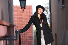 Young fashion woman  in the city street. Royalty Free Stock Photos