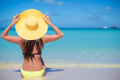Young fashion woman in hat on the beach Stock Image
