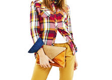 Young fashion woman holding a handbags. Royalty Free Stock Images