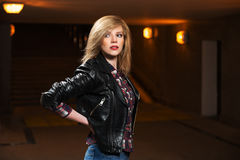 Young fashion woman in leather jacket Stock Photos