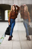 Young fashion woman in leather jacket with handbag Stock Photos