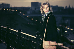Young fashion woman in a night city street Stock Image