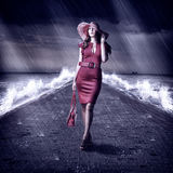 Young fashion woman is on pier during storm Royalty Free Stock Photography