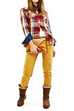 Young fashion woman in plaid shirt, holding a handbags Stock Image