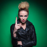 Young fashion woman is pointing her finger up Royalty Free Stock Images