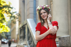 Young fashion woman posing. Beautiful young fashion woman in color dress posing outdoor Stock Image