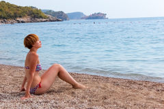 Young fashion woman relax on beach Stock Image