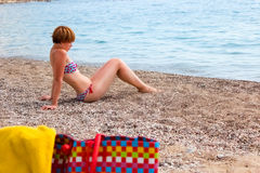 Young fashion woman relax on beach Royalty Free Stock Photo