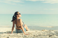 Young fashion woman relax on the beach. Stock Photos