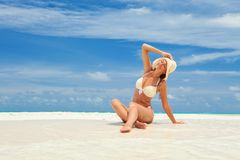 Young fashion woman relax on the beach. Happy lifestyle. stock photos