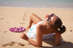 Young fashion woman relax on the beach, sun worshiper. Stock Photography