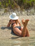 Young fashion woman relax on the beach. In sunny day Stock Photography