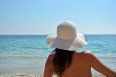 Young fashion woman relax on the beach. In sunny day Stock Image