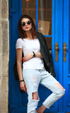 Young fashion woman in retro rock style on street Stock Image