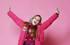 Young fashion woman in short violet down jacket. royalty free stock images