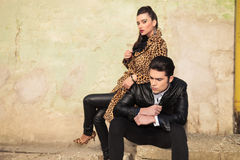 Young fashion woman sitting behind her lover Stock Images